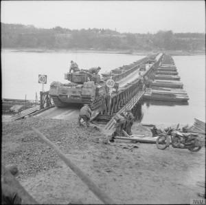 A Churchill tank of 6th Guards Tank Brigade crossing a pontoon bridge over the Elbe, 30 April 1945. © IWM (BU 4895)