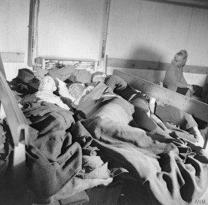 Homeless German civilians sleeping in one of Hamburg's large public air raid shelters. © IWM (BU 10917)